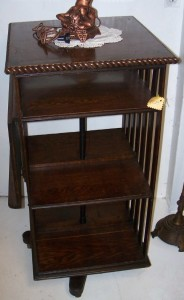 Original Finish Oak Rotary Book Shelf with Adjustable Reading Shelf.